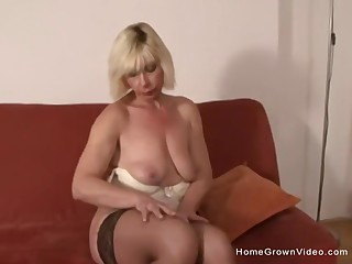 Mature blonde gets a chubby black cock shoved up her ass