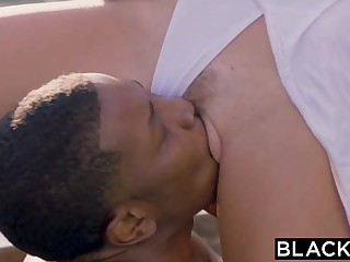 Cute blond tart, Natalia Starr is edgily throating 2 ebony schlongs, next to the pool